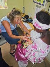 Sandi Speech Pathologist giving meds