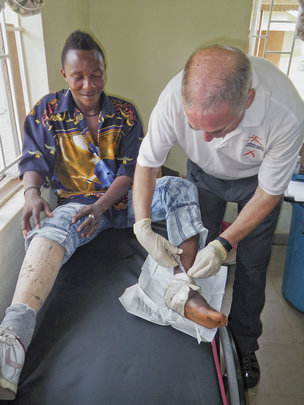 Don, PT with an amputee with schrapnel in his foot
