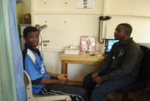 Mohamed with Philip Sesay, GGM Clinic Director