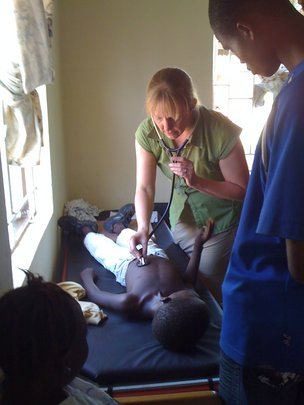 Dr. Keech examining a patient