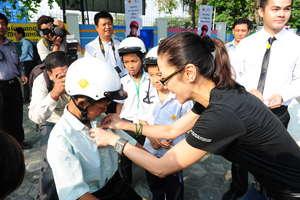 Michelle Yeoh Fitting Helmet on Student
