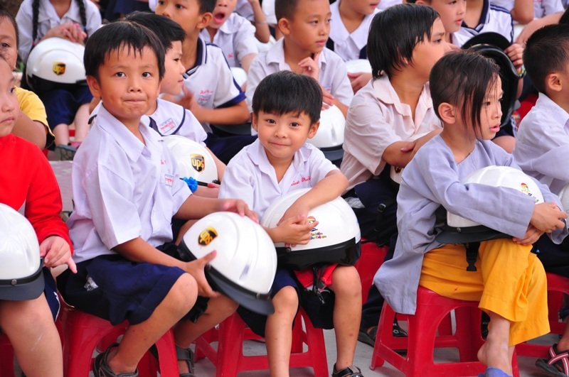 Students at Pham Van Chieu school with new helmets