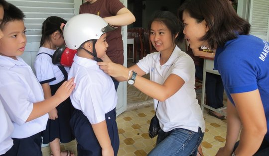 Properly-sized helmets protect students' heads.