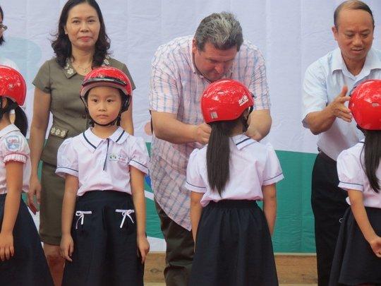 Students receive helmet donations in September.