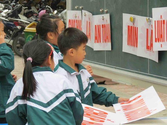 Students team up to complete the road safety game.