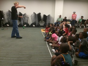 Our kids at the library for a magical science show