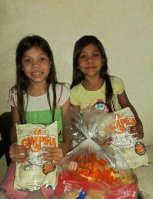 Students holding milk from food bag delivered