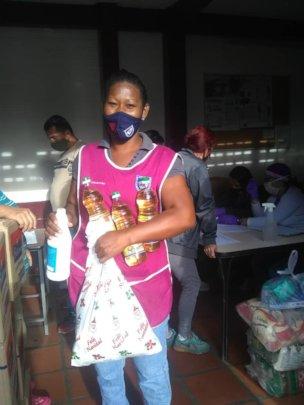 School staff receiving food &personal hygiene bags