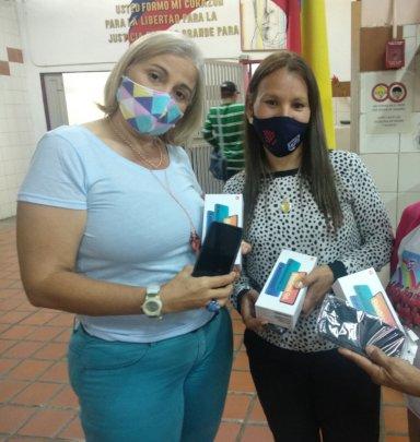 Teachers receiving cell phones +  telephone line