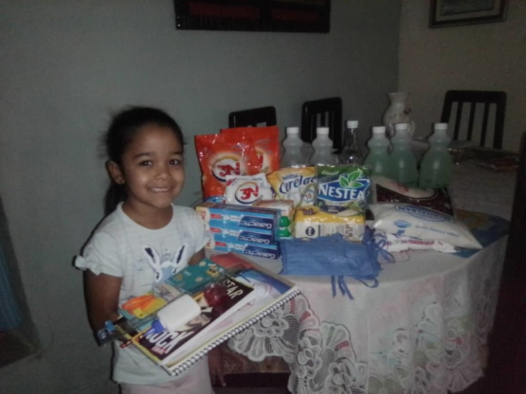 Student with food, hygiene items & school supplies