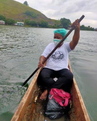 Midwife Lili Suebu travelling across Lake Santani