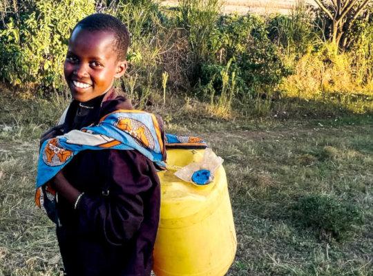 Jackline fetching water after school