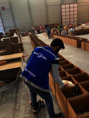 Volunteer preparing supplies for beneficiaries