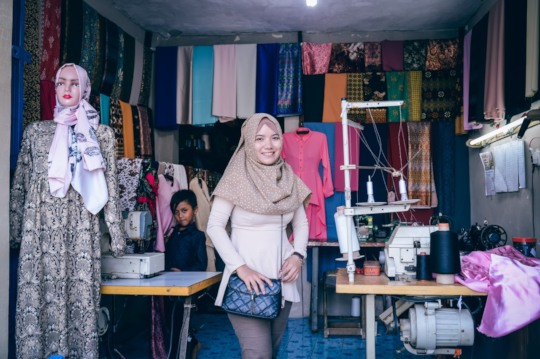 Warti, who opens a clothing store.