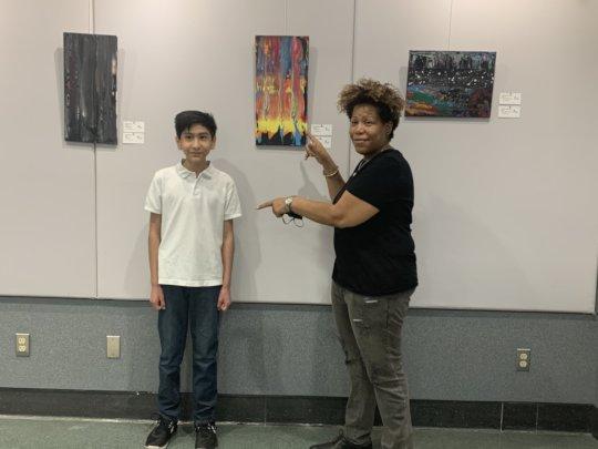 Art instructor Lisa Jones with budding art student