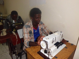 Ermias at his sewing machine