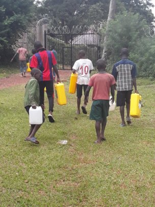 Children fetching water during dry season
