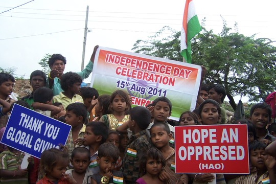 CHILDREN SALUTING OUR NATIONAL FLAG