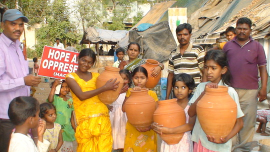 Children and parents happy to receive the pots