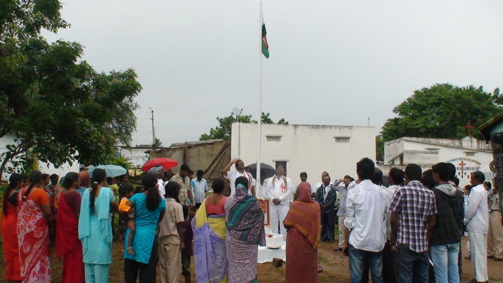 Community leader flag hoisting