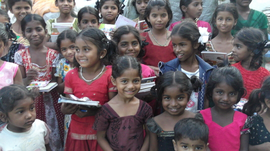 happy and cheerful children after receiving needs