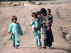 Children in barren field