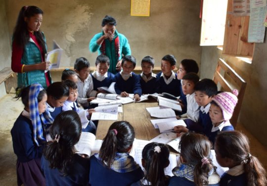 our sponsored students teaching children.