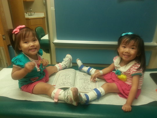 Charlet and sister Laila with their braces