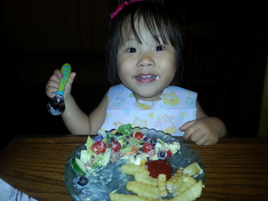Little Charlet enjoying dinner