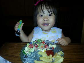 Little Charlet enjoying dinner