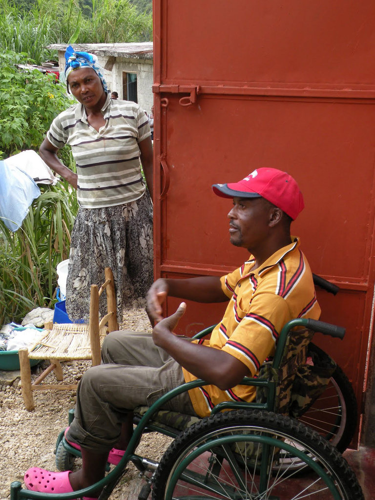 Robert outside his home in Haiti