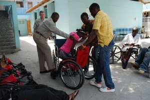 Student receiving a new wheelchair