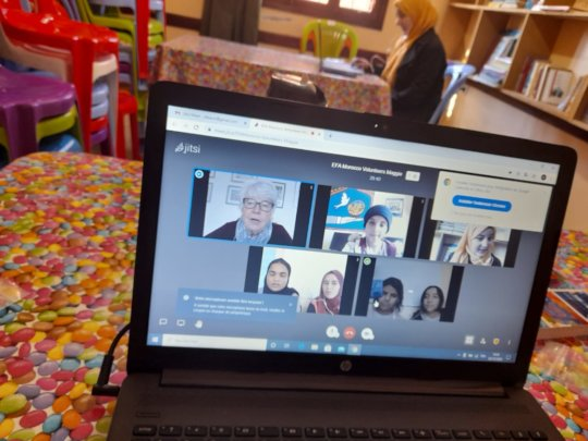 Using a laptop to connect with volunteers