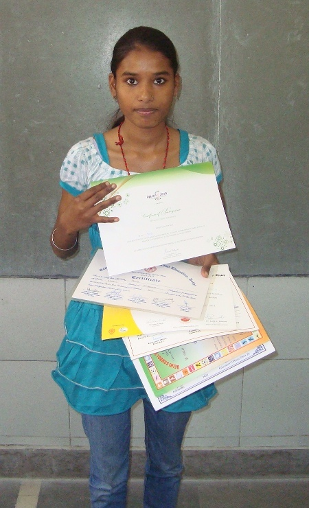 Pooja showing her award cetificates