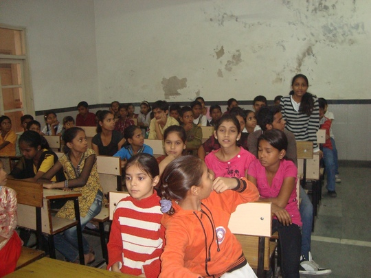 A girl sharing her views with the group.