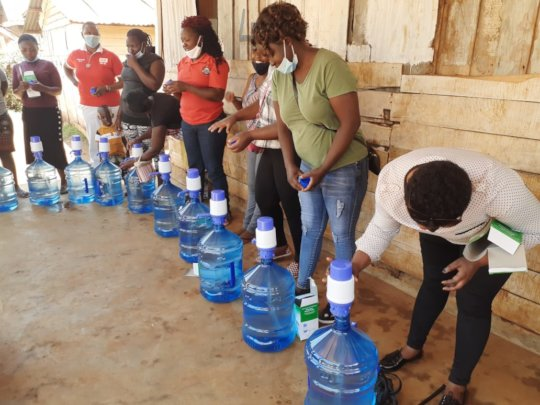 Distribution of water bottles and Water hand press