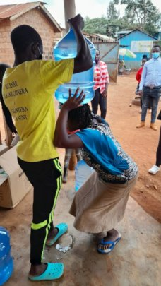 Helping a woman get water to her head
