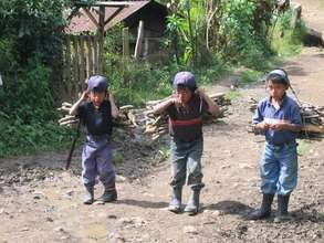Young boys carrying firewood in Chajul