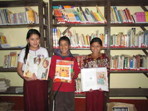 Students show off new library books