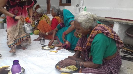Deprived Old age women having nutritious meals