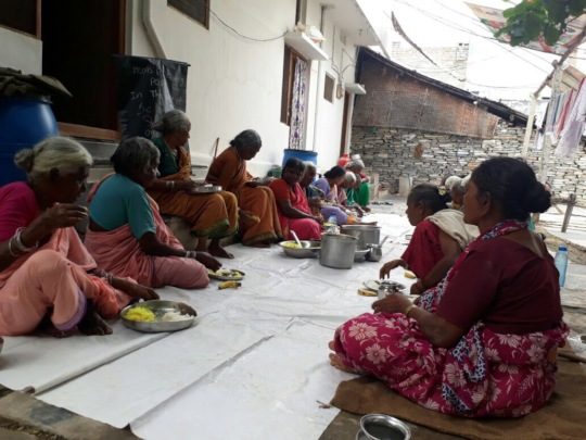 elderlyperson getting monthly food donation by ngo