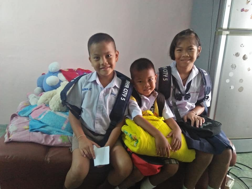 Children of family celebrate first day of school