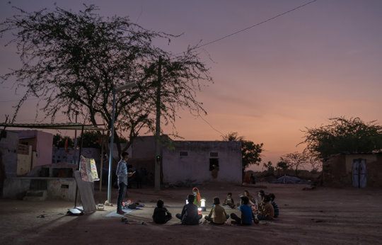 Shankar Jat teaches students at the night school.