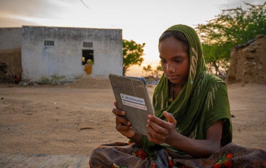 Norti, 11, attends digital night school in Indole.