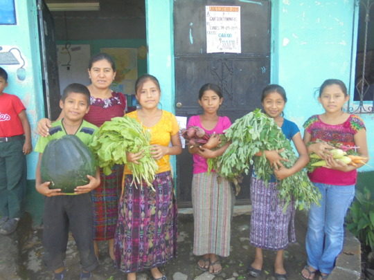 Students with some of their harvest in Nueva Vida