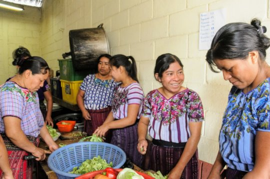Participants chat as they prepare vegetables