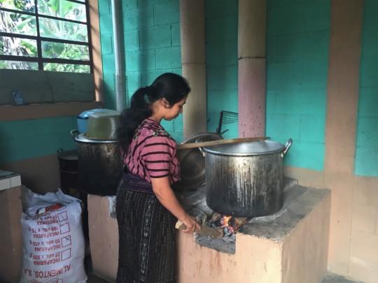 Preparing food in the new kitchen at La Cumbre