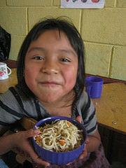 A student in Tzanchaj II enjoying her breakfast