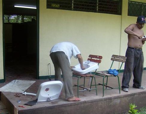 Men working to repair bathrooms