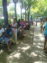 Families lined the walkway waiting for care